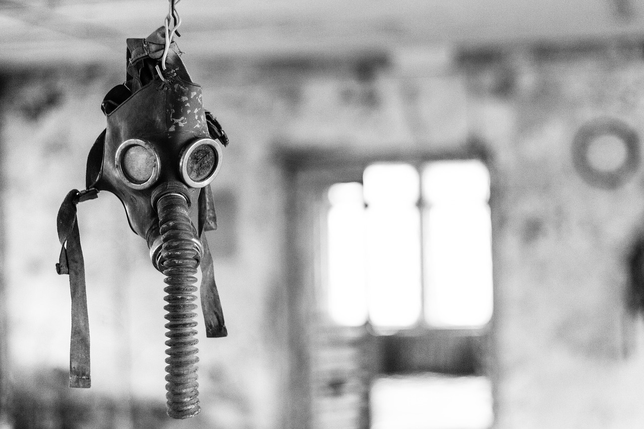 a gas mask hangs from a ceiling in Chernobyl