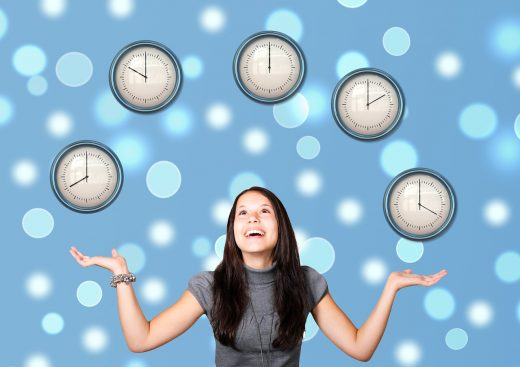 Woman juggling clock faces