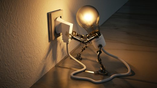 anthropomorphized light bulb plugs in its own cord