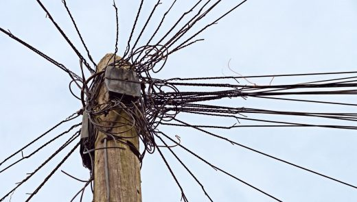 cables attached to telephone pole