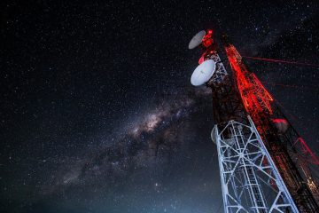 radio antenna tower against Milky Way backdrop